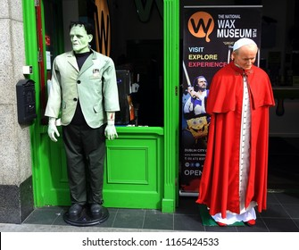 26th August 2018 Dublin. Waxworks of Pope John Paul II and the Frankenstein monster on Westmoreland street when Pope Francis passed by in his pope mobile touring Dublin City.