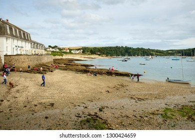26th July 2017 - St Mawes, Cornwall: Visitors enjoy the beach at low tide on a summer afternoon  in St Mawes on the Roseland Peninsula, Cornwall, UK