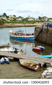 26th July 2017 - St Mawes, Cornwall: Passengers on the May Queen  a small passenger ferry, arrive at the harbour on a summer afternoon in St Mawes, Roseland Peninsula, Cornwall, UK
