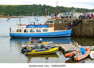 26th July 2017 - St Mawes, Cornwall: Passengers board The Duchess of Cornwall, a St Mawes Ferry boat, in the harbour on a summer afternoon at St Mawes on the Roseland Peninsula, Cornwall, UK