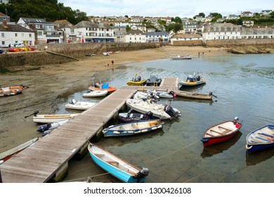 26th July 2017 - St Mawes, Cornwall: Visitors enjoy the sands at low tide on a summer afternoon  in St Mawes in the Roseland Peninsula, Cornwall, UK