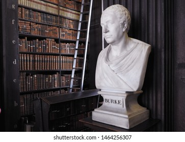 26th July 2019, Dublin. Bust of Burke from sculptor John Hickey in 18th century in The Long Room of the Old Library at Trinity College Dublin, home to The Book of Kells and 20,000 rare books.