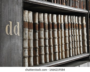 26th July 2019, Dublin. A couple of old books in focus, the rest have a soft blurred focus, from the Long Room of the Old Library at Trinity College Dublin, the home to the Book of Kells.