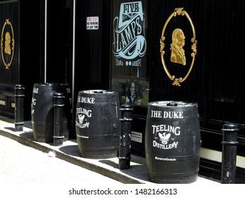 26th July 2019, Dublin, Ireland. Teeling whiskey branded wooden barrels outside of The Duke traditional Irish pub, located in Duke Street, off Grafton Street.