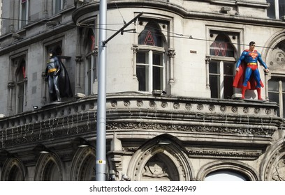 26th July 2019, Dublin, Ireland. Wax works of Superman and Batman on a city centre window ledge in Westmoreland Street to promote the  wax works in The National Wax Museum.