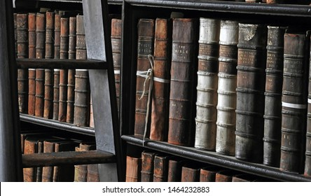 26th July 2019, Dublin. A step ladder beside old books in soft blurred focus, from the Long Room of the Old Library at Trinity College Dublin, the home to the Book of Kells.