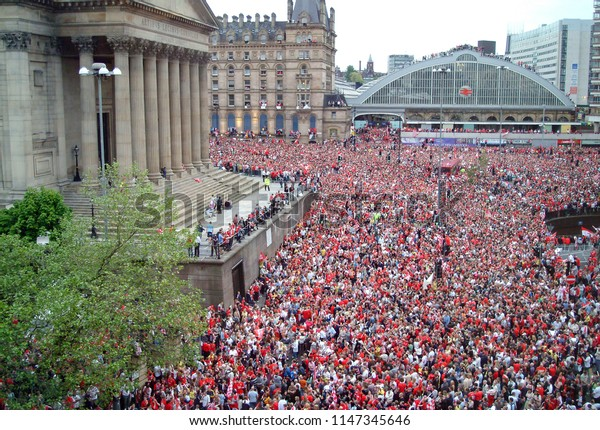 26th May, 2005, Liverpool UK. Fans gather outside Lime Street station for the victory parade of  Liverpool Football Club after winning the Champions league final in Istanbul