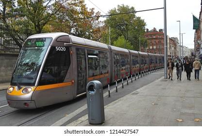26th October 2018 Dublin.  A light rail Luas tram train running through the end of Grafton Street in Dublin City Centre.