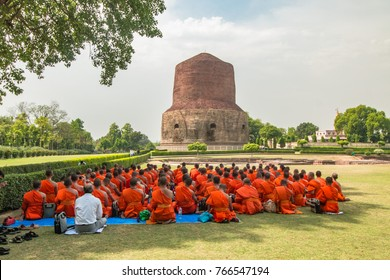 [27 April 2015] Group of Buddhist monks perform religious activity at Dhamekh Stupa, the place for first Buddha teaching in Panchaytan temple ruins, Sarnath, Varanasi, India.