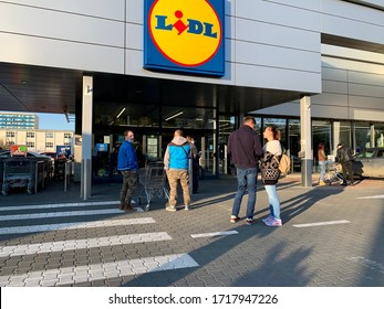 27 April, 2020. Cluj-Napoca, Romania. People queue.  Lidl supermarket with social distancing queue during the coronavirus pandemic. Calm people. Editorial use only