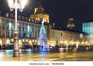 27 December 2017, Torino (TO) Italy: View of one of the main squares of Turin (Piazza Castello). Christmas artist lights lit above the road.