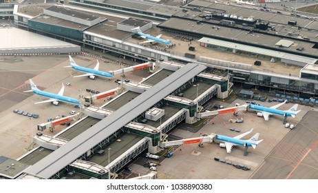 27 January 2018, Amsterdam, Holland. Aerial view at Schiphol Airport of four KLM airliners at the gate and a Fokker 100 museum plane at the panorama  deck.