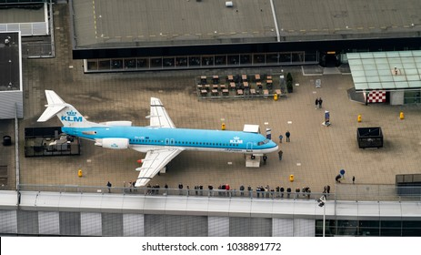 27 January 2018, Amsterdam, Holland. Aerial view at Schiphol Airport of a KLM Fokker 100 airliner standing at the panorama deck. It is a museum plane.