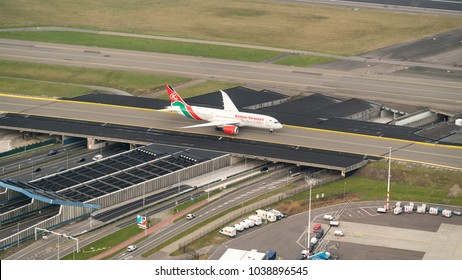 27 January 2018, Amsterdam, Holland. Aerial view at Schiphol Airport of a Kenia Airways Boeing 787 Dreamliner crossing a bridge over a highway.