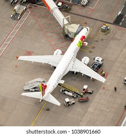 27 January 2018, Amsterdam, Holland. Aerial view at Schiphol Airport of a TAP Portugal Embraer 190 airliner at the gate.
