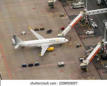 27 January 2018, Amsterdam, Holland. Aerial view at Schiphol Airport of a Spanish Vueling Airbus at the gate.