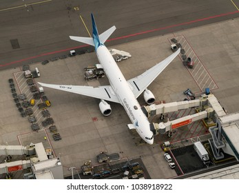 27 January 2018, Amsterdam, Holland. Aerial view at Schiphol Airport of a Garuda Indonesia Boeing 777 at the gate.