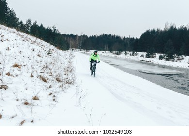 27 JANUARY 2018, Minsk, Belarus: Winter minus 100 Cross-country and cross-country cycling competitions in winter Two men riding bicycles