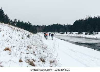 27 JANUARY 2018, Minsk, Belarus: Winter minus 100 Cross-country and cross-country cycling competitions in winter A group of people riding a bicycle