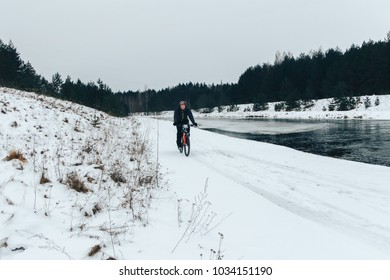27 JANUARY 2018, Minsk, Belarus: Winter minus 100 Cross-country and cross-country cycling competitions in winter The man is riding a bicycle