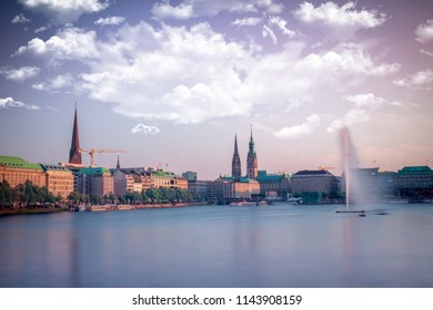 27 July 2018, Hamburg-Germany: Jungfernstieg fountain , and the town hall in a sunny day.