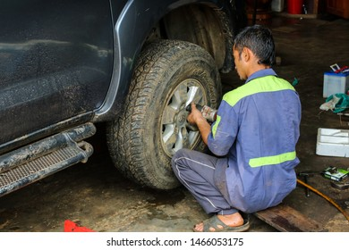 27 July 2019 The car repairman was repairing the car at the service center in the process of car maintenance. Pang Mapha District Mae Hong Son Province, Thailand