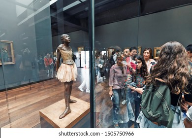 27 July 2019, Orsay museum, Paris, France: Visitors walk through the spacious halls of the Museum and admire the ballerina sculpture of Edgar Degas