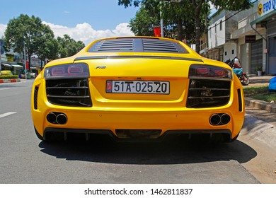 27 July 2019 - Vung Tau City, Vietnam: Back of 2014 Audi R8 in yellow color on the street