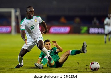 27 June 2019, Egypt, Cairo: Senegal's Sadio Mane (R) and Algeria's player for the ball during the 2019 Africa Cup of Nations Group C soccer match between Senegal and Algeria at the 30 June Stadium.