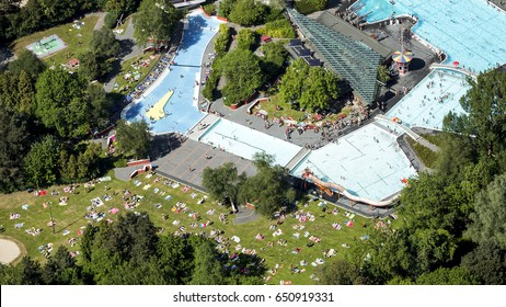 27 May 2017, Groningen, Holland. Aerial view of swimming pool De Papiermolen on a very hot day in the spring. Blue water and green fields with people sunbathing