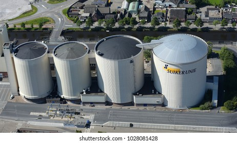 27 May 2017, Groningen, Netherlands. Aerial view of four huge storage tanks at the sugar factory of the Dutch Suiker Unie.