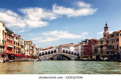 27 May 2018-Bridge Rialto on Grand canal famous landmark panoramic view Venice Italy with blue sky white cloud