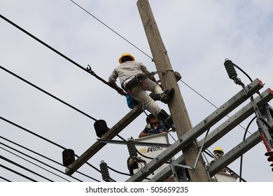 27 october 2016,songkhla thailand,electrican working on electric pole