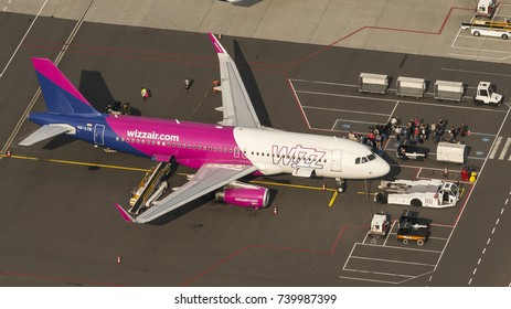 27 September 2017, Eindhoven, Holland. Aerial shot of a Wizzair Airbus at Eindhoven Airport. Passengers are waiting in line to board the airplane.