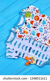 27.04.2018 - Kyiv, Ukraine. Boy and girl cotton bodysuits. New baby cotton brand jumpsuits and accessory, top view.