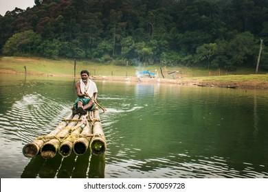 27/10/2016 Periyar National Park India, villager approaches on bamboo raft