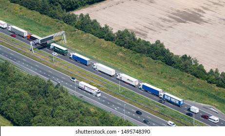 27-6-2019, Hazeldonk, Holland. Aerial view of traffic jam at highway A16, the freeway to Belgian border. A lot of trucks are stuck in traffic.