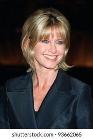 "27OCT97:  Actress/singer OLIVIA NEWTON JOHN at the premiere in Los Angeles of ""Mad City"" which stars John Travolta & Dustin Hoffman. Olivia starred with Travolta in ""Grease"" in 1978."