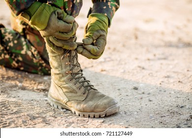 27rangers boots and hands tying bootlaces in desert