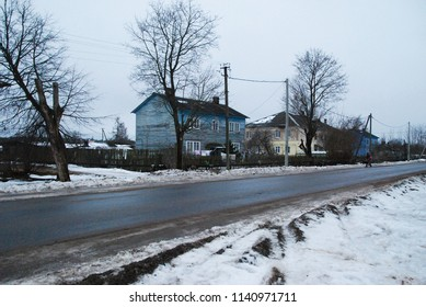 27th of December 201 - Winter scene from russian town with view past empty toad to residential buildings, Ust Luga, Russia