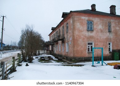 27th of December 2017 - Scene from Russian town with view to a deserted road and an old residential building, Ust Luga, Russia