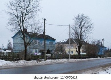 27th of December 2017 - Winter scene from Russian town with view past an empty road to residential houses, Ust Luga, Russia