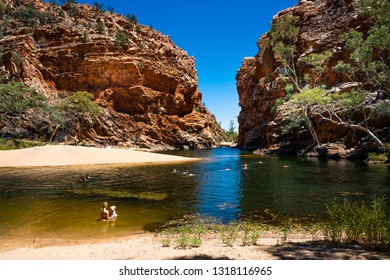 27th December 2018, NT Australia : People swimming in Ellery creek big hole in the West MacDonnell Ranges NT outback Australia