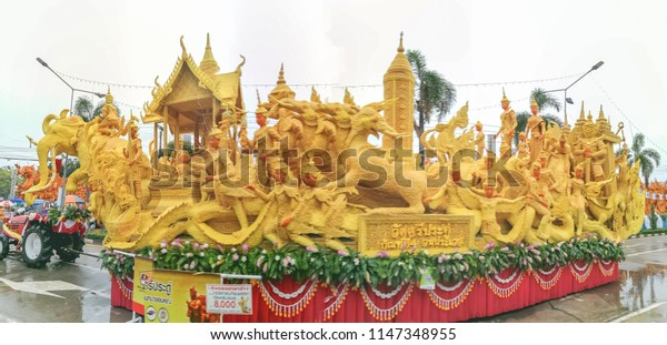 28 Jul 2018: Ubon Ratchathani, Thailand; Was Sri Praduu, The winner of Pin up art of wax plate at Candle Festival and Parade, the art of faith,  Khao Phansa day(The Buddhist Lent Day).