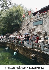 "‎⁨Jinan⁩, ⁨Shandong⁩, ⁨China⁩ - 28 June 2015: People visit to see the pound water of the famous ""Black Tiger Spring"" in Jinan."