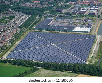 28 June 2018, Middelburg, Holland. Aerial bird view of solarpark De Mortiere. The photovoltaic powerstation supplies the city with green energy.