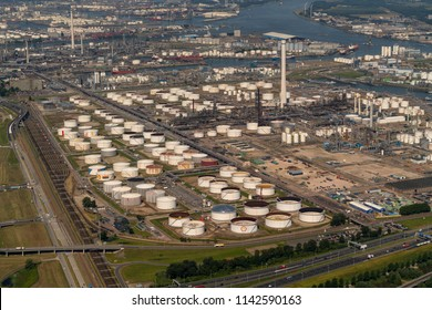 28 June 2018, Rotterdam, Holland. Aerial bird view of Shell Pernis. It is the largest refinery in Europe. On this photo a lot of oil storage tanks. and the chemical installation.