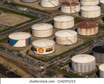 28 June 2018, Rotterdam, Holland. Aerial bird view of oil storage tanks with a big shell logo at Shell Pernis. It is the largest refinery in Europe.