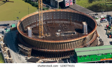 28 June 2018, Rotterdam, Holland. Aerial view of the construction site for the enlargement of the Museum Boijmans van Beuningen. A big brown round circle with a large crane