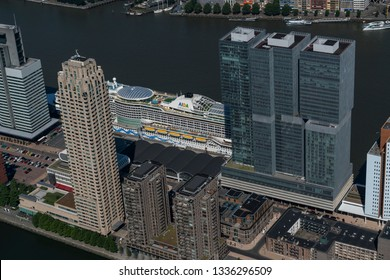 28 June 2018, Rotterdam, Holland. Aerial view of cruiseship at the passenger terminal at the WILHELMINAKADE at THE KOP VAN ZUID. High rise skyscrapers at the pier in river MAAS.